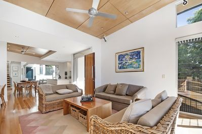 Open plan living area with high ceilings which captures ocean breezes