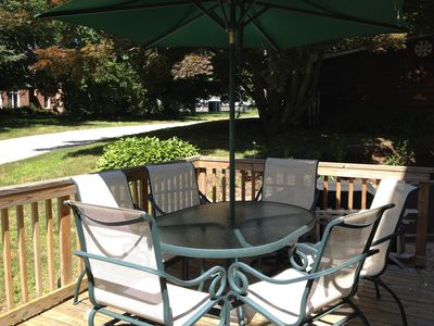 Outdoor porch wth dining set and BBQ