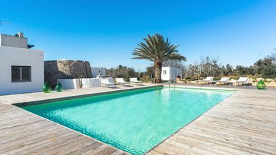 Photo for Typical property with swimming pool completely surrounded by secular olive trees and Mediterrean maq