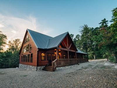 Photo for Luxurious cabin nestled in the picturesque woods