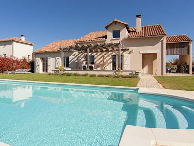 Photo for Luxury detached villa with heated pool overlooking a challenging golf course.