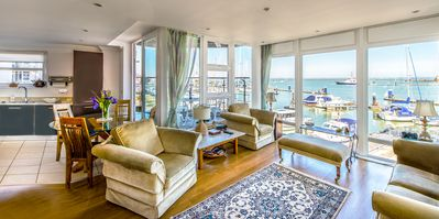 Photo for Luxury Cowes waterfront apartment with stunning panoramic marina & sea views