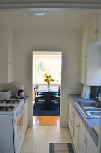 Full kitchen going into breakfast nook looking out bay window