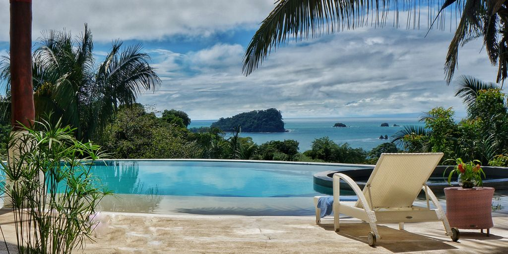 Manuel antonio estate rental day or night come and relax poolside with a cool