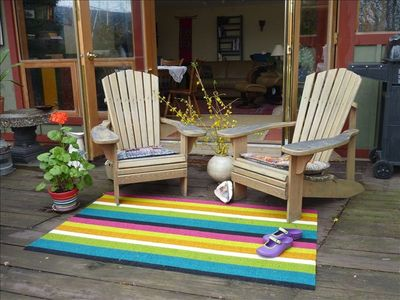 ease into relaxation, beautiful lakeside deck, admire the bird antics or just be