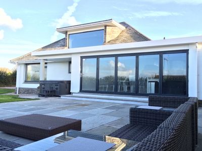Photo for STUNNING CONTEMPORARY COASTAL HOLIDAY HOME WITH HOT TUB, SEA VIEWS AND PARKING