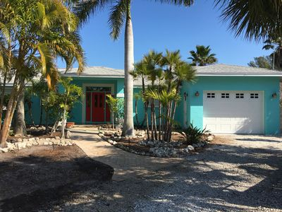 Photo for North end canal front secluded home with tiki hut, dock, heated pool, jacuzzi