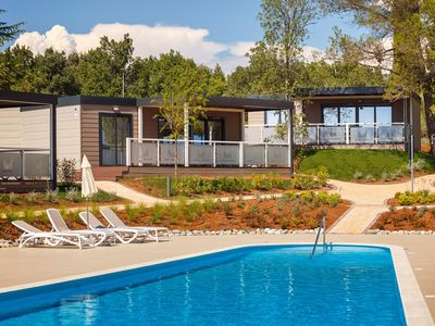 Photo for Modern chalet with two bathrooms, in holiday park with beautiful swimming pool