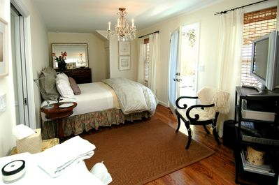 Bedroom with door leading to private, landscaped deck