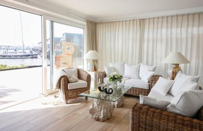 Photo for Stylishly furnished apartment with direct Baltic Sea views, large terrace, beach chair and sauna