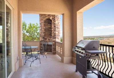 Oversized balcony with fireplace and BBQ not to mention the views
