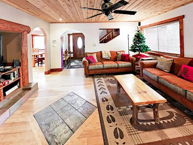 Living Area - With all the charm of a rustic-chic log cabin, the living room has abundant seating for the whole family.