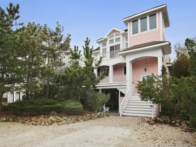 Photo for FREE DAILY ACTIVITIES!! Located only two homes from the ocean, this 5 bedroom, 4.5 bath home is located in a small exclusive gated community.
