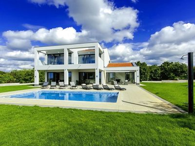 Photo for Luxurious villa with large garden, pool, jacuzzi, playground and outdoor kitchen