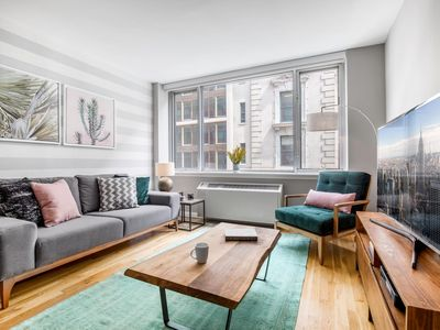 Photo for Welcoming Chelsea 1BR w/ Roof deck, Gym + Doorman by Blueground