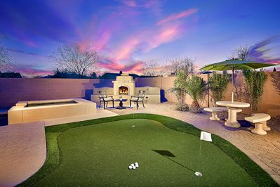 Fun putting green and outdoor fire place.