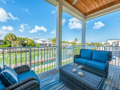Photo for 4 BR/3 BA Canal Front Villa with Private Pool, Dock and Neighborhood Beach!