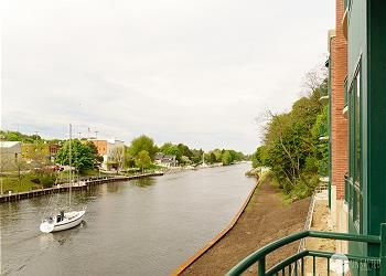 Photo for Captain's Quarters: 2 BR Downtown Condo on Manistee River! (Sleeps 6)