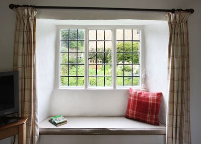 Window seat in sitting room with view of garden