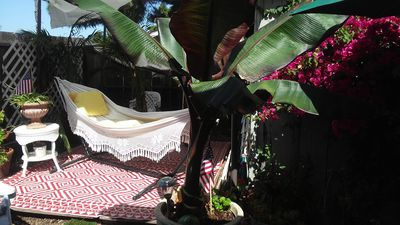 Brazilian hammock in the shade.  Umbrella lights up at night.