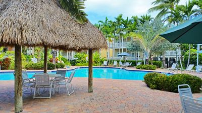 large pool lies in the middle of the coral hammock  plex just steps from your doorway  island days   spacious   coral hammock   ho      vrbo  rh   vrbo