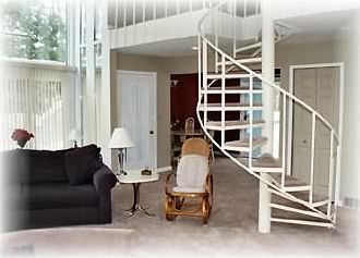 A spiral staircase leads to the second level where there are two bedrooms.