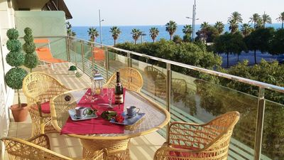 Photo for Sea, sand beach, large balcony, marina, pool, underground parking,
