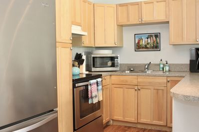 Fully equipped kitchen, with microwave, full size fridge, blender & coffee pot