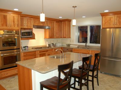 Photo for 5 bedroom single family home with private hot tub walk to Sachem Trail!