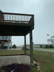 View of the beach from sundeck located at the end of the covered deck