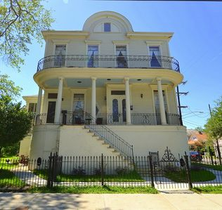 A grand antebellum home with great architectural features on a gated property.
