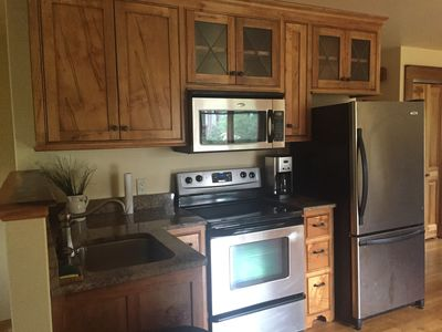 Fully equipped kitchen, granite countertops, wormy maple cabinets.