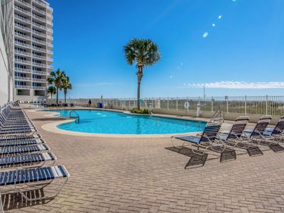 Photo for Beachfront condo w/ access to shared pools, hot tubs, fitness center & sauna!