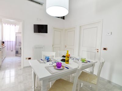 Photo for 90sqm apartment. for 6 people with covered garage