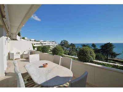 Photo for Beautiful penthouse with private rooftop pool right by the sea