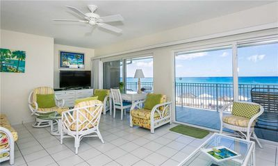 Photo for Take in panoramic ocean views from this 3-bedroom penthouse condo on Seven Mile Beach