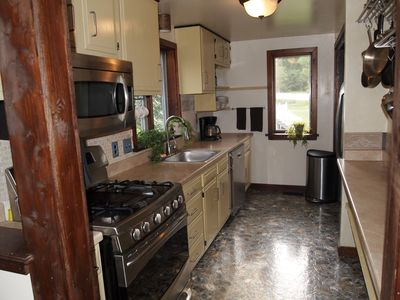 BRIGHT KITCHEN WITH  2 WINDOWS, ALL STAINLESS STEEL APPLIANCES, AND GAS COOKING