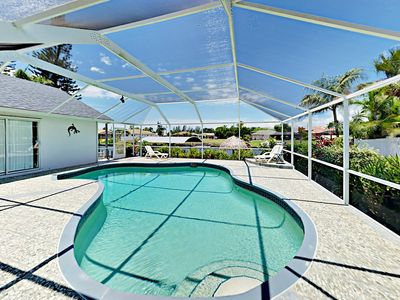 Photo for Canal-Side 4BR w/ Screened-in Pool, Boat Dock & Gulf Access - Near Dining