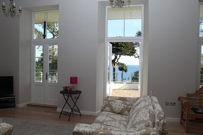Doors out to terrace with sea views