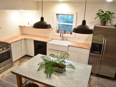 Photo for Location! Pet-friendly! Charming Farmhouse! Sleeps 6! Near the Square and UoAR!