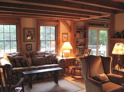Partial View of large living room with large wood burning fireplace (and wood!)