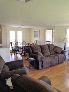 Kitchen opens up to living room. Living room has 2 reclining couches & recliner