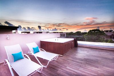 Enjoy a sunset on the private huge deck with jacuzzi for 4 people