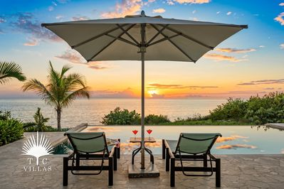 Private pool overlooking the sunset behind Sapodilla Bay.
