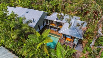 Photo for Elevated amongst the trees, this light and breezy home has a resort feel