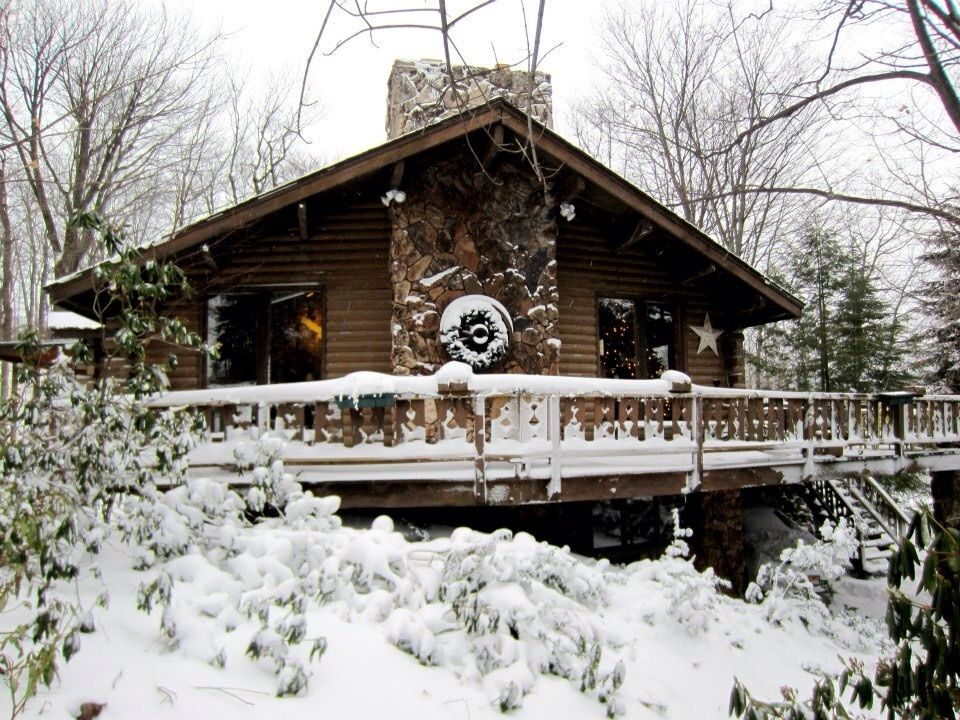 an imagination of staying in a charming log cabin in the mountains With a charming and cozy indoor space but staying true to each other the log cabin offers gorgeous views of the lake and rooster's inn has two game rooms.