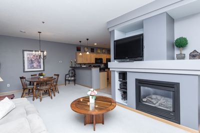 Modern, open floor plan.  Living room, dining space and kitchen.