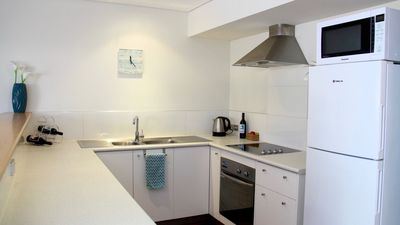 Fully equipped kitchen with fridge, microwave, stove/oven, toaster, kettle