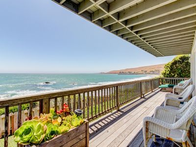 Photo for Watch for dolphins and whales from this oceanfront rental w/ fireplace & deck