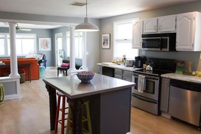 New kitchen with stainless steel appliances & center island. Filled with light!